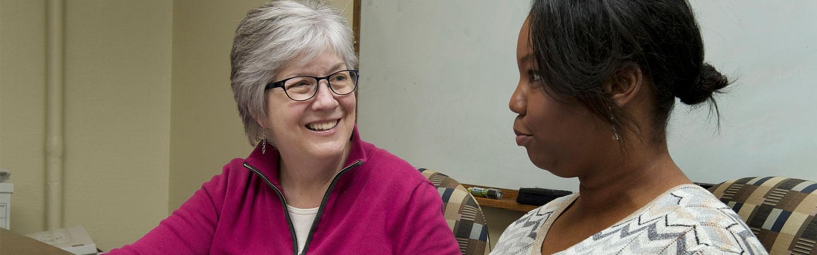 Julie Kalkowski and student at Creighton University