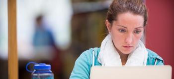 Graduate student on laptop computer